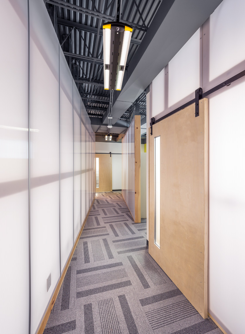 Corridor of Contemporary Office Space with Big Ass Lights