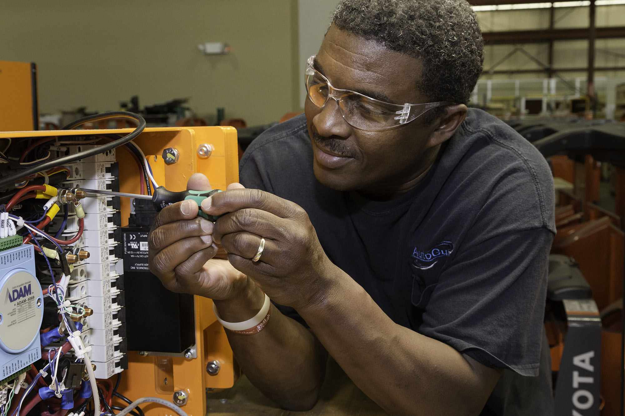 detail of man working in robotics fabrication