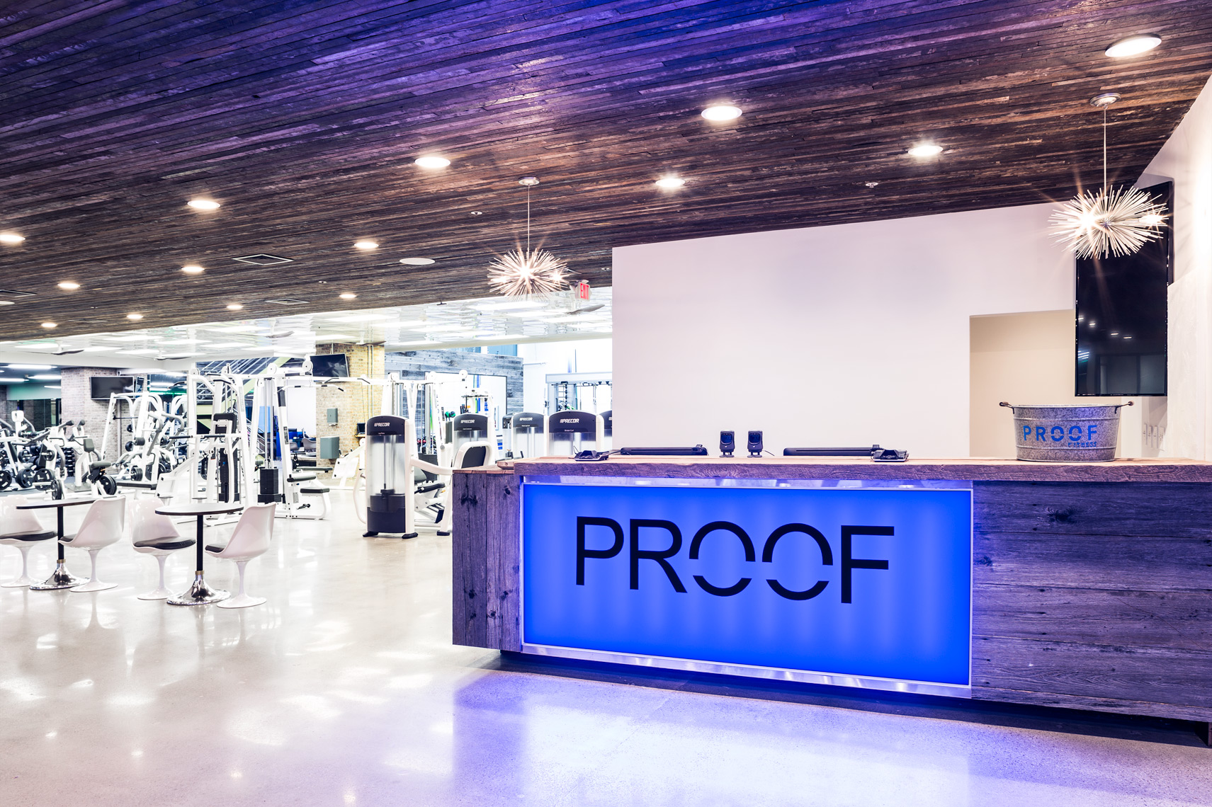 Reception area and machines at Proof Fitness