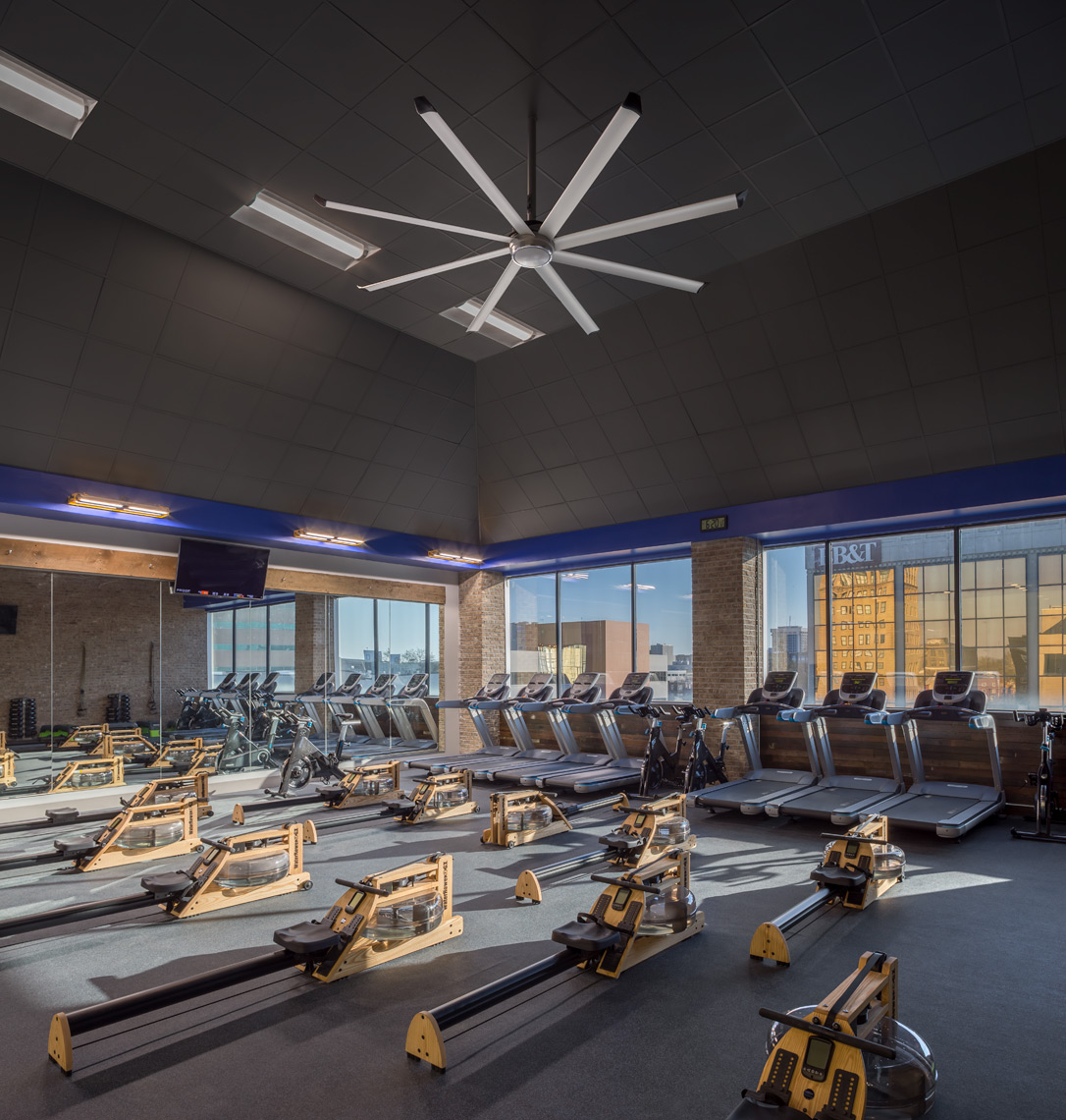 Rowing gym and treadmills at proof fitness with lighting application
