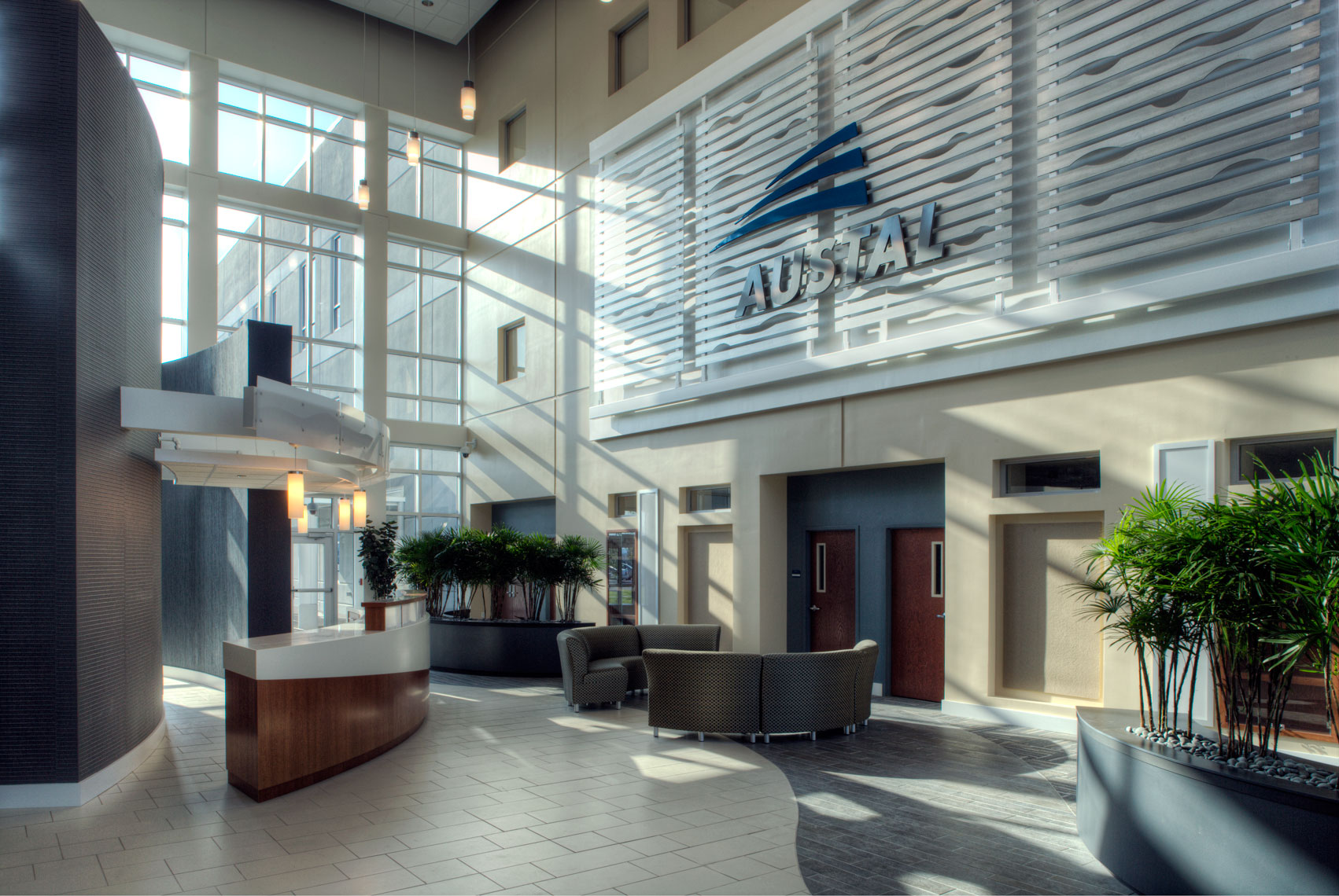 Sunlit atrium and reception at Austal USA