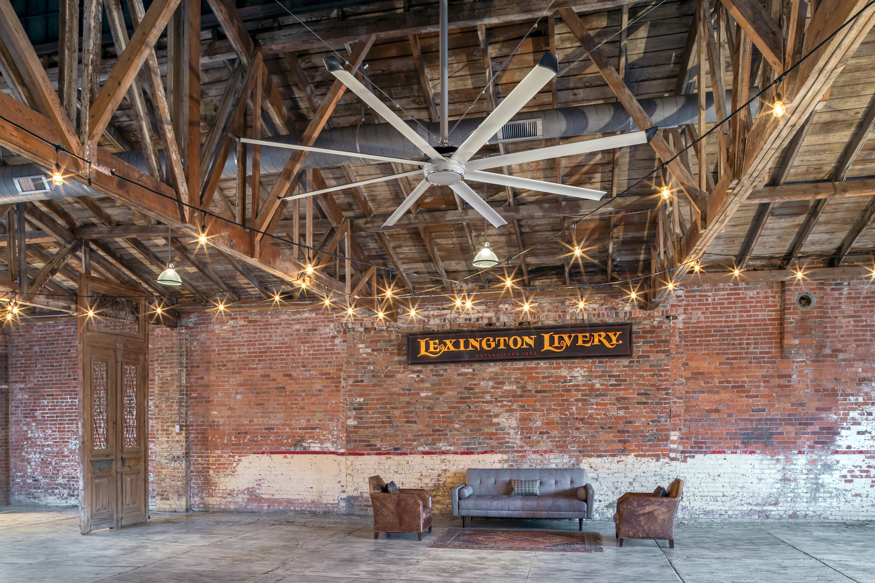 historic urban livery renovated to event space with fan