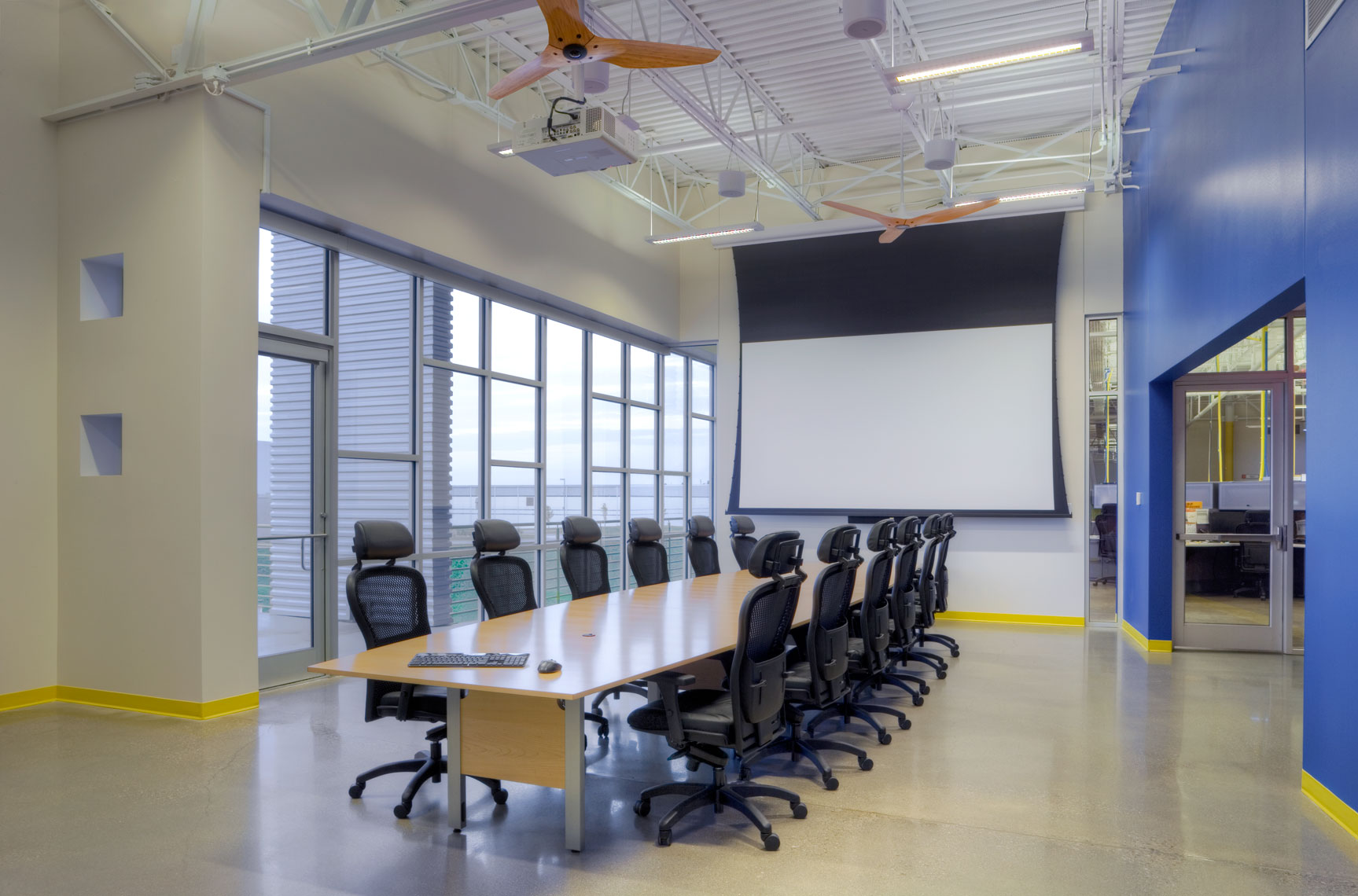 architectural conference room with long table and windows