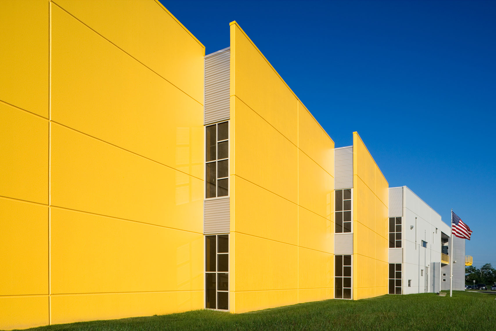yellow corporate building with flags