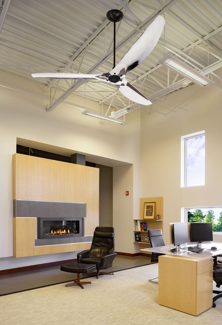 executive office suite with fireplace and chrome ceiling fan
