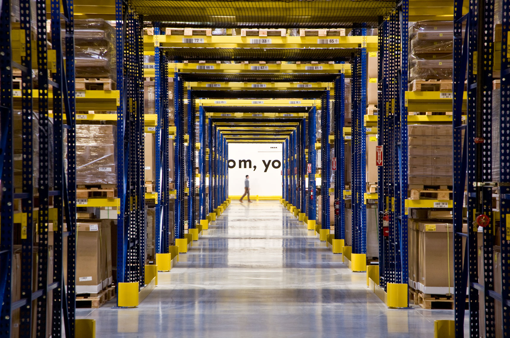 Man walking through extensive IKEA Distribution Center