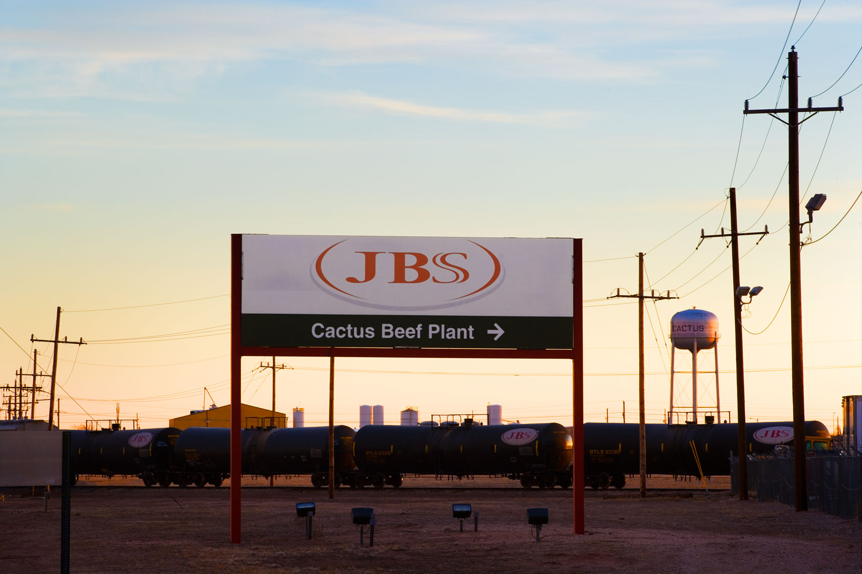 Signage and railroad at beef processing plant in Cactus Texas