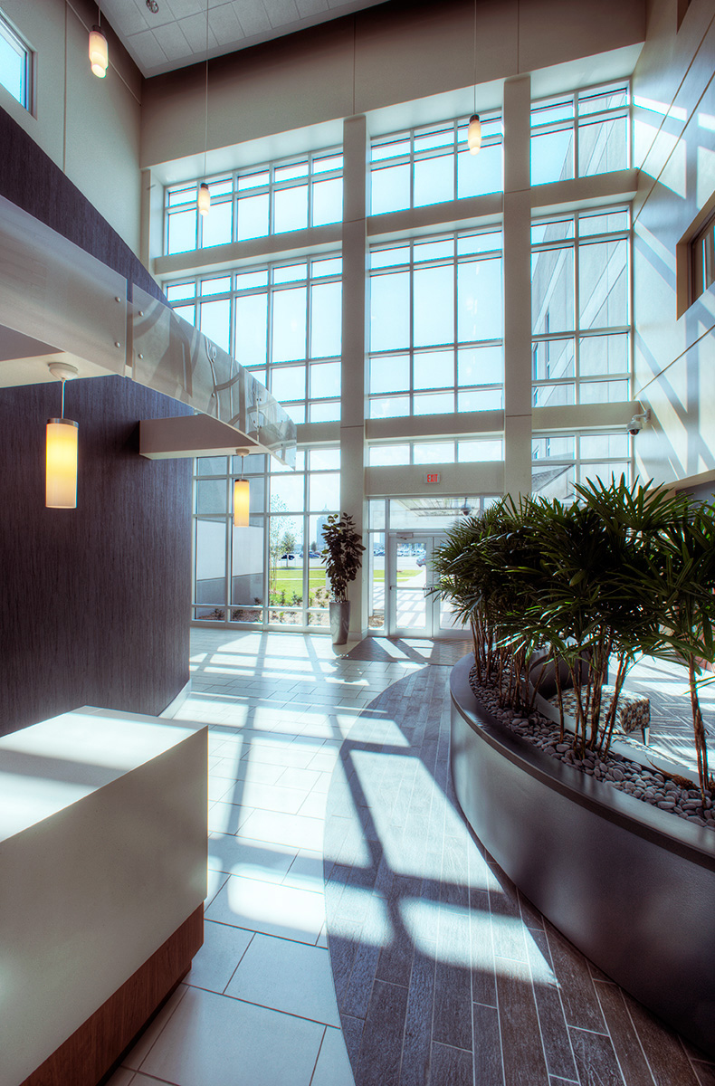 Detail of Sunlit atrium and reception at Austal USA