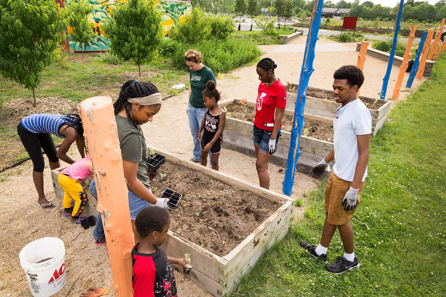 families working on garden plots at urban vacant lot