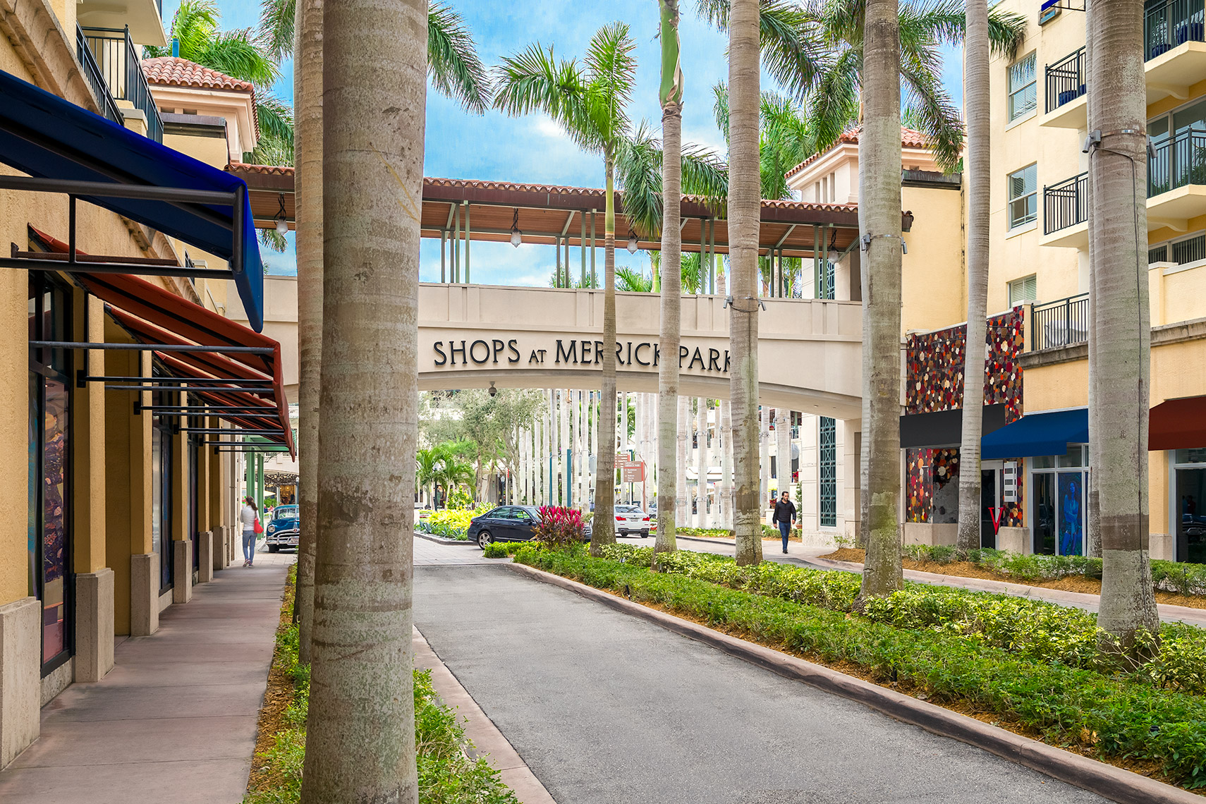 Colonnade of palm trees at entrance to Shops At Merrick Park