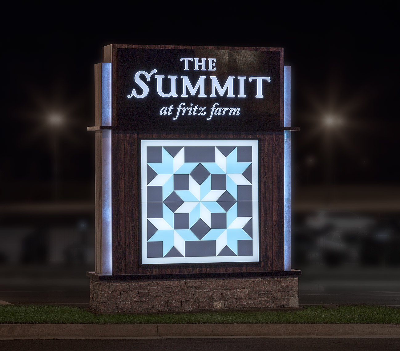 "lighted entrance monument at night ""the Summit at fritz farm"""