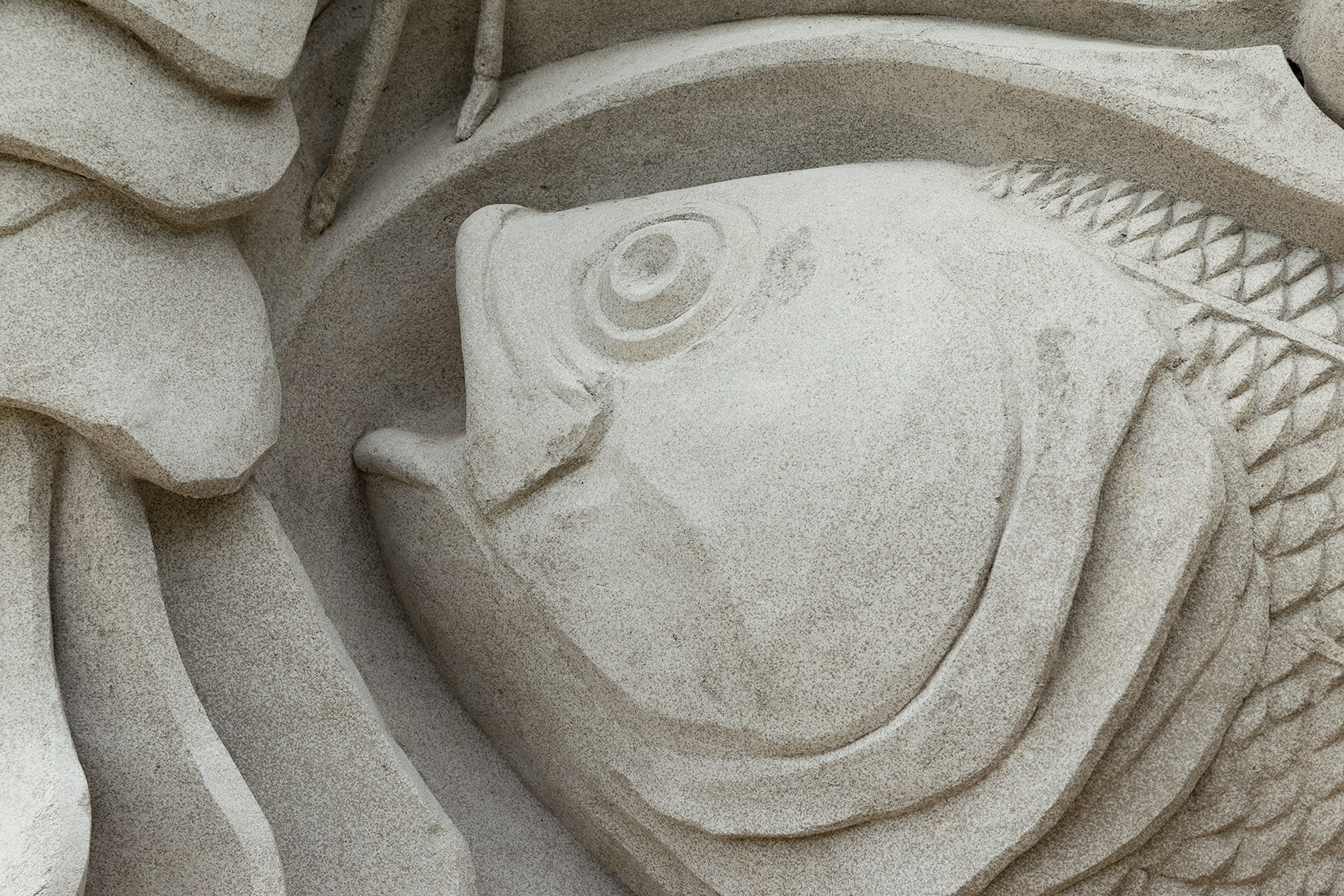 fish artwork detail on spring giant concrete sculpture at botanic garden