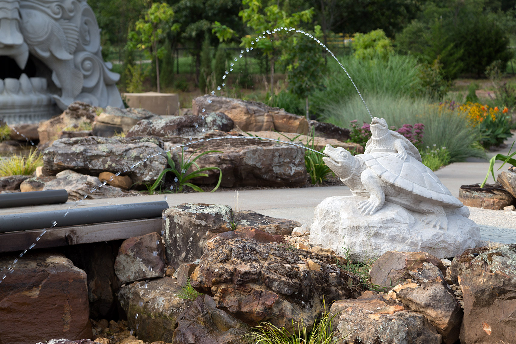 turtle sculptures spraying water at tulsa botanic garden